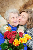 Granddaughter kissed grandmother — Stock Photo