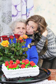 Girl with elderly woman — Stock Photo