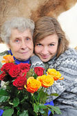 Granddaughter with grandmother — Stockfoto