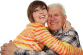 Happy grandchild hugs a happy grandad — Stock Photo