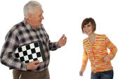 Grandad called granddaughter to play a chess — Stock Photo