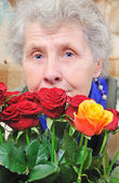 Dreamy elderly woman — Stock Photo
