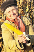 Happy grandmother with maize — Stock Photo