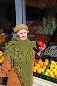 Grandmother on market — Stock Photo
