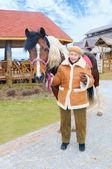 Granny near horse — Stock Photo