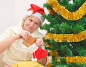 Granny with Christmas stocking — Stock fotografie