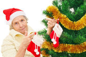 Granny in red Santa Claus hat and red socks — Stock Photo