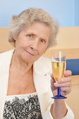 Mother with goblet of champagne — Stock Photo