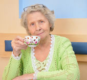 Senior woman with cup of tea — Stock Photo