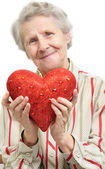 Senior woman with heart — Stock Photo