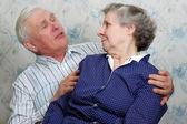 Grandfather something tells grandmother — Stock Photo
