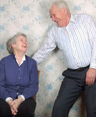Happy old couple laugh until one cries — Stockfoto