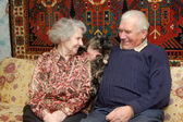 Seventy year old couple smiling in home — Stock Photo