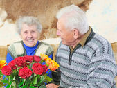 Old woman with roses — Stock Photo