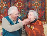 Elderly man and elderly woman — Stock Photo