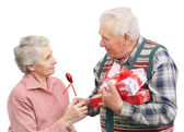 Senior men give gifts — Stock Photo