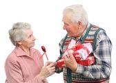 Senior men give gifts — Stock Photo
