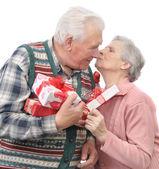 Senior men give gifts senior women — Stock Photo