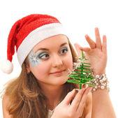 Snow maidan look at small Christmas tree — Stock Photo