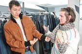 Friends in wear shop — Stock Photo