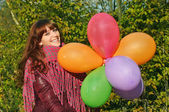 Girl with colorful balloons outdoor — Stock Photo