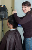 Hairdresser make clips to the men — Stock Photo