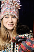 Beautiful young girl in winter hat and mittens — Stock Photo