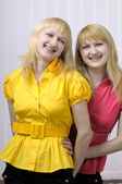 Two smiling blond sisters — Stock Photo
