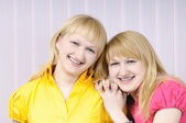 Portrait of two attractive blond sisters — Stock Photo