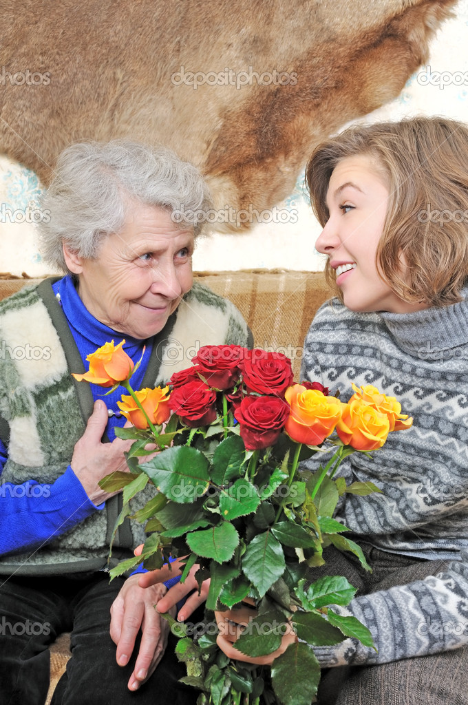 Girl make a present elderly woman — Stock Photo #8885049