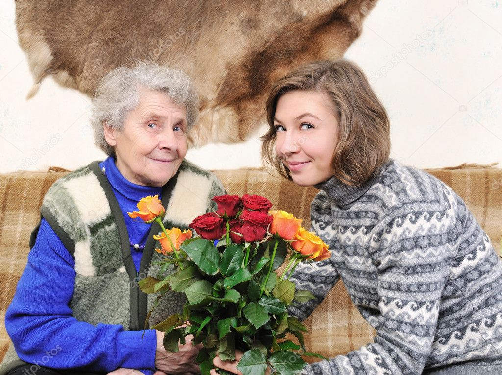 Grandmother and granddaughter with bouquet rose — Stock Photo #8885057