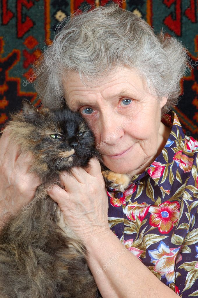 Grandmother sitting with cat on her hands — Stock Photo #8885573