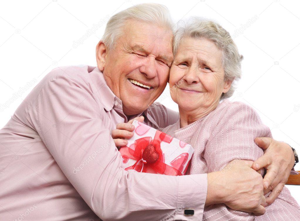 couple de personnes g es souriant et bo te cadeau photographie boguslavovna 8886317. Black Bedroom Furniture Sets. Home Design Ideas