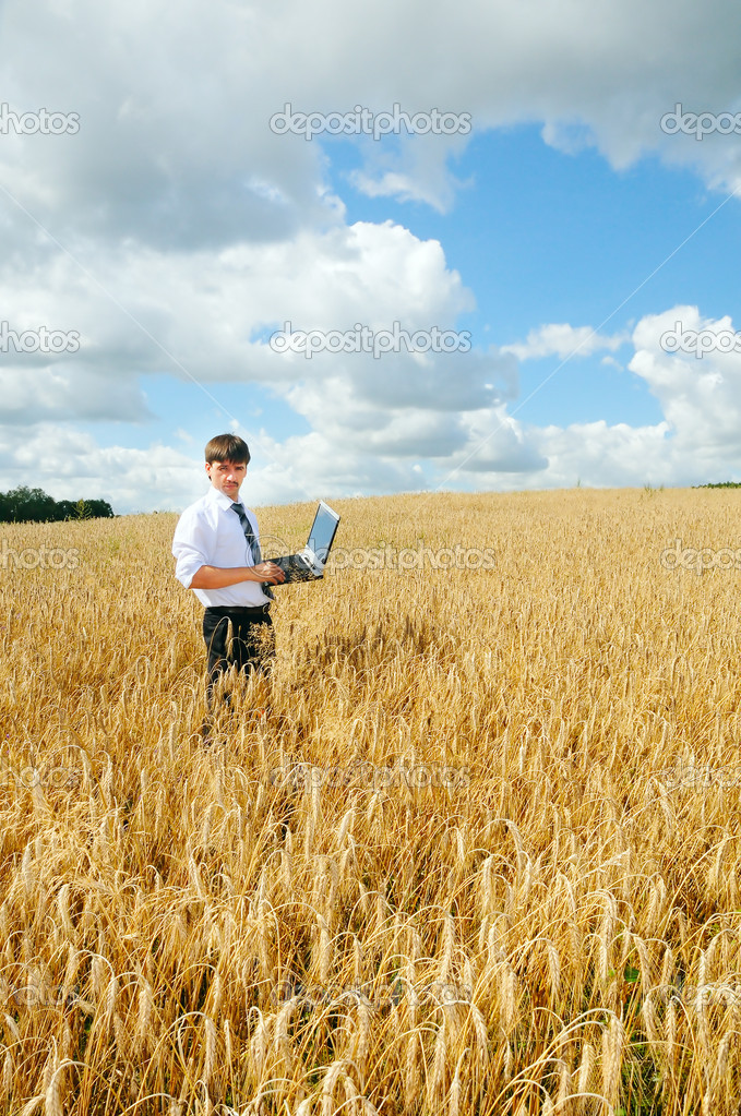 Young adult businessmen in the field with laptop — Stock Photo #8887797