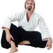 Pacification teacher of aikido sit and look at camera — Stock Photo