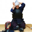 A woman puts on kendo uniform — Stock Photo