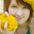 Beautiful girl with red hair and yellow dandelions — Stock Photo #8912368