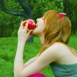 Girl nibble apple — Stock Photo #8912421