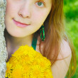 Girl with diadem from yellow dandelions on head — Stock Photo #8912464