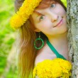 Royalty-Free Stock Photo: Pretty girl and diadem from yellow dandelions on head