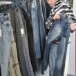 Boy choice jeans in shop — ストック写真