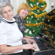Granny and daughter prepare to Christmas — Stock Photo