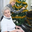 Granny and daughter prepare to Christmas - Stock Photo