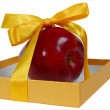 Red apple in box with yellow tape like gift — Stock Photo #8913827