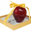 Red apple in box with tape-line like gift — Stock Photo #8913835