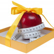 Red apple in box with tape-line like gift — Stock Photo