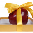 Red apple in box with yellow tape like gift — Stock Photo