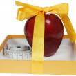 Red apple in box with tape-line like gift — Stock Photo #8913877