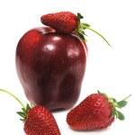 Apple with three ripe strawberry — Stock Photo