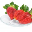 Three ripe strawberry on plate — Stock Photo #8914740